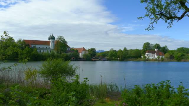 St. Walburgis church and Seeon Monastery on Lake Seeon, Chiemgau, Bavaria, Germany, Europe