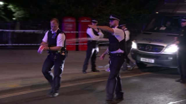 one dead and five injured england london russell square police vehicles and cordon tape at scene of knife attack [woman killed and fived injured in... - 刺傷事件点の映像素材/bロール