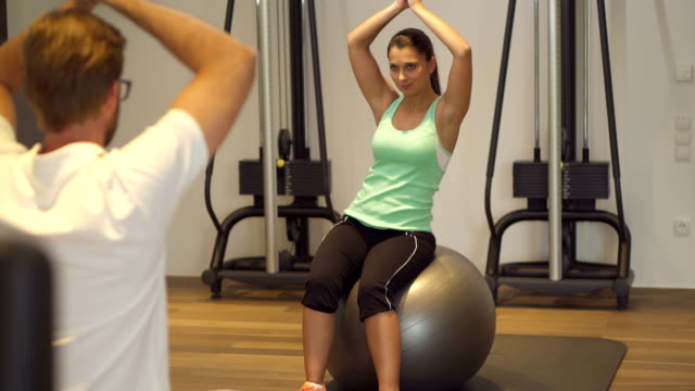 stabilisation exercises in gym - fitness ball stock videos and b-roll footage