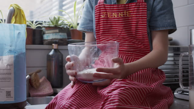 cs, stabilized handheld - child holding bowl containing flour - striped stock videos & royalty-free footage