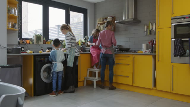 fs, stabilized handheld - multi racial family making breakfast - family with two children stock videos & royalty-free footage