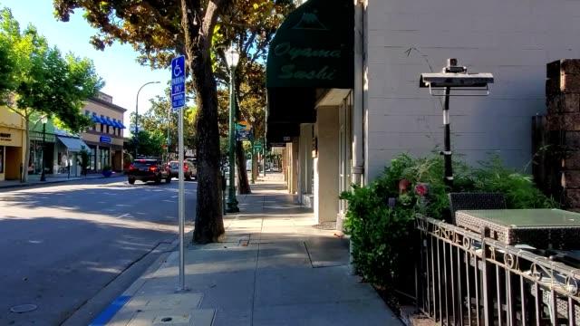 Stabilized shot moving along Main Street past restaurants in downtown Walnut Creek California July 2019