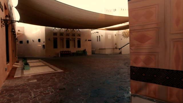 stabilized tracking shot in the katara cultural village in doha, qatar - doha stock videos & royalty-free footage