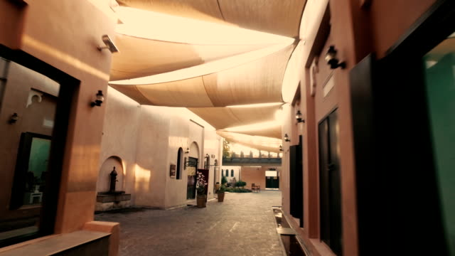 stabilized tracking shot in the katara cultural village in doha, qatar - qatar stock videos & royalty-free footage