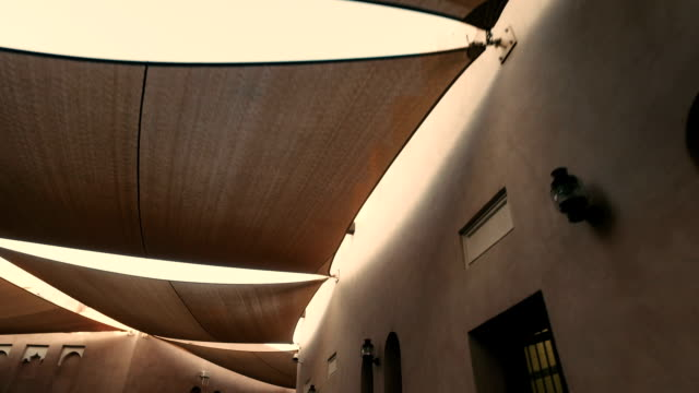 stockvideo's en b-roll-footage met stabilized tracking shot in the katara cultural village in doha, qatar - doha