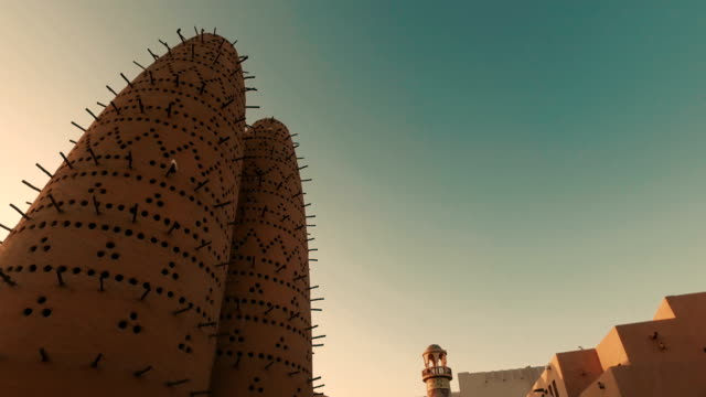 stabilized tracking shot in the katara cultural village in doha, qatar - minareto video stock e b–roll