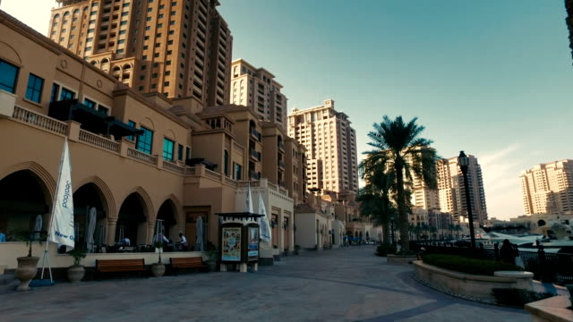 "stabilized tracking shot in ""the pearl-qatar"" in doha, qatar - qatar stock videos & royalty-free footage"