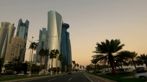 vídeos de stock, filmes e b-roll de stabilized tracking shot through the streets of doha, qatar - qatar