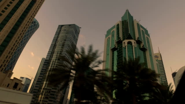 stabilized tracking shot through the streets of doha, qatar - doha bildbanksvideor och videomaterial från bakom kulisserna