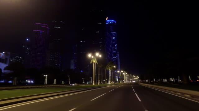 stabilized tracking shot through the streets of doha, qatar - 車の視点点の映像素材/bロール