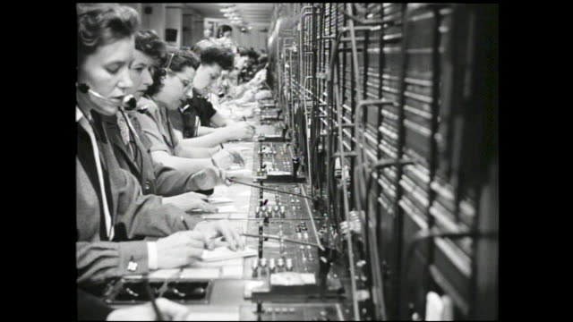 """stable view from different perspectives of female telephone operators at work talking into their headsets; close up of wooden crates """"produce of new... - customer service representative stock videos & royalty-free footage"""