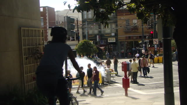 stable view of people crossing the street on market street outdoor food stall with banner funnel cakes and people dressed in white cooking emitting... - emitting stock videos & royalty-free footage