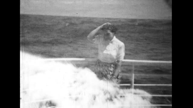 stable view of ship sailing on the ocean; superimposition of girl leaning against the railing of the ship and the ocean waves crashing - multiple exposure stock videos & royalty-free footage