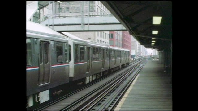 stable view of subway approaching mostly empty cta station, couple of people getting off - chicago 'l' stock videos & royalty-free footage