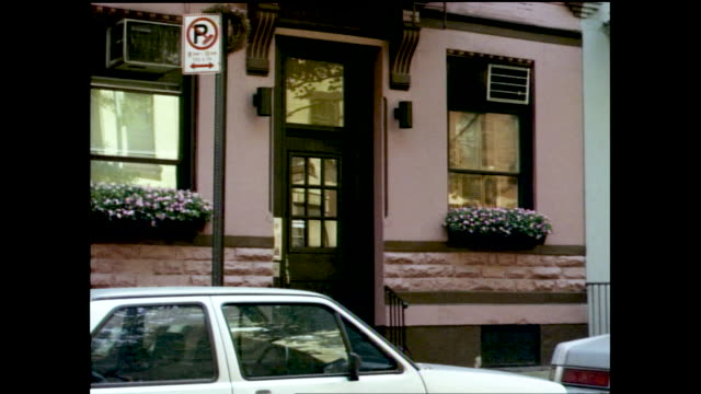 """stable views of cars parked by the sidewalk next to """"no parking"""" sign; pink building with flower boxes; people walking on the sidewalk; entrance to a... - no parking sign stock videos & royalty-free footage"""