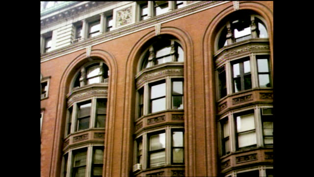 stable views of tall ornate building with windows, carvings, and arches - ornate stock videos & royalty-free footage