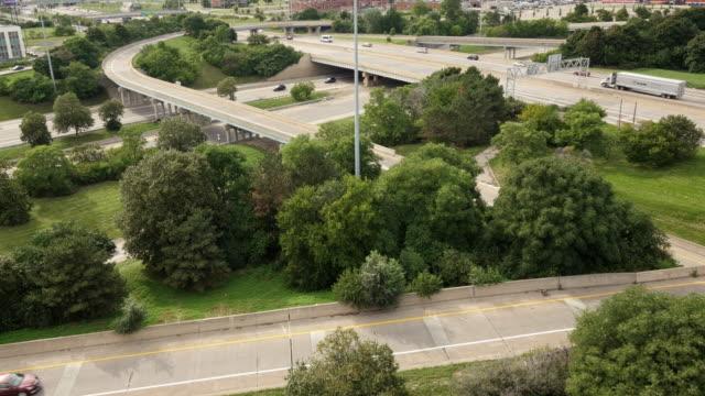 stack interchange detroit. fisher freeway. medium wide shot from above. - spoonfilm stock-videos und b-roll-filmmaterial