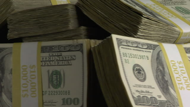 cu, stack of american dollar bills in paper band rotating - greed stock videos and b-roll footage