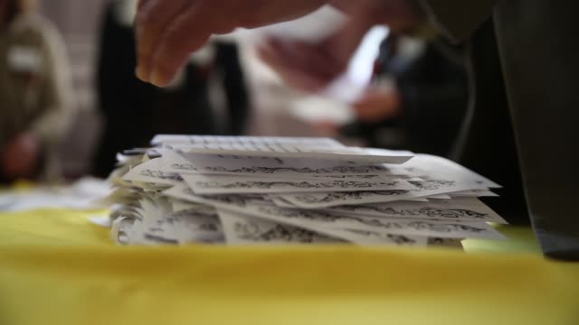 cu stack of ballot slips an election official counts votes in a polling station in the lenin palace of culture in slovyansk in eastern ukraine... - eastern european culture stock videos and b-roll footage