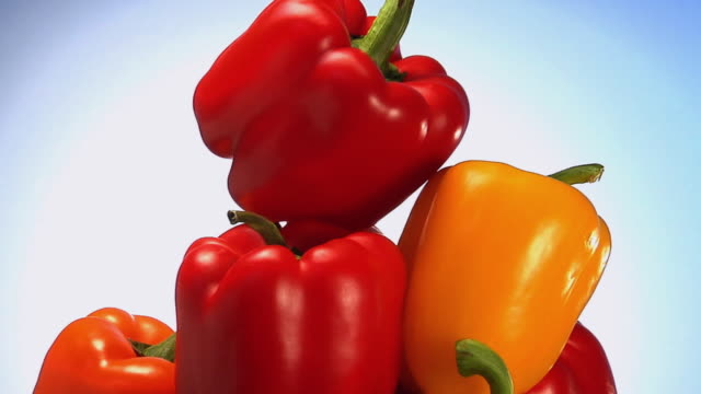 cu, stack of bell peppers rotating - medium group of objects stock videos & royalty-free footage