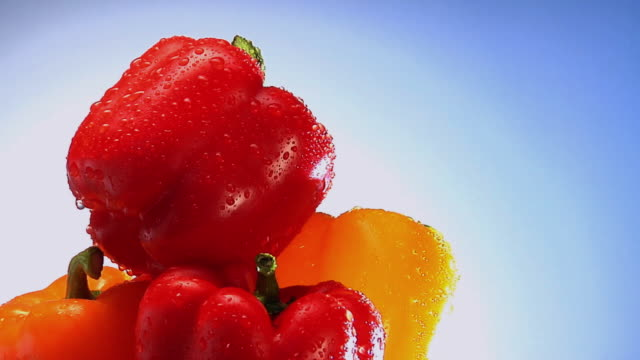 CU, Stack of bell peppers with water droplets rotating