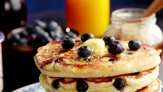 stack of blueberry pancakes with butter and maple syrup - stack of plates stock videos & royalty-free footage
