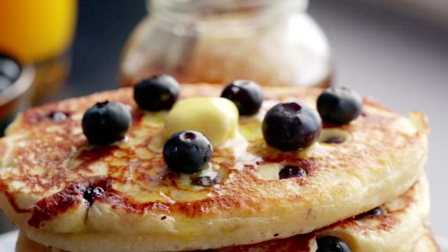 stack of blueberry pancakes with butter and maple syrup - syrup stock videos & royalty-free footage