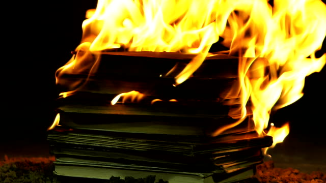 stack of books burning - censorship stock videos & royalty-free footage