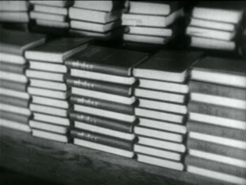 b/w 1934 stack of books / documentary - textbook stock videos & royalty-free footage