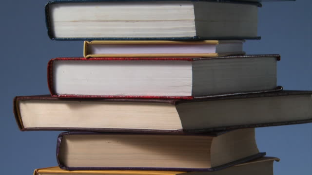 stack of books - book stock videos & royalty-free footage