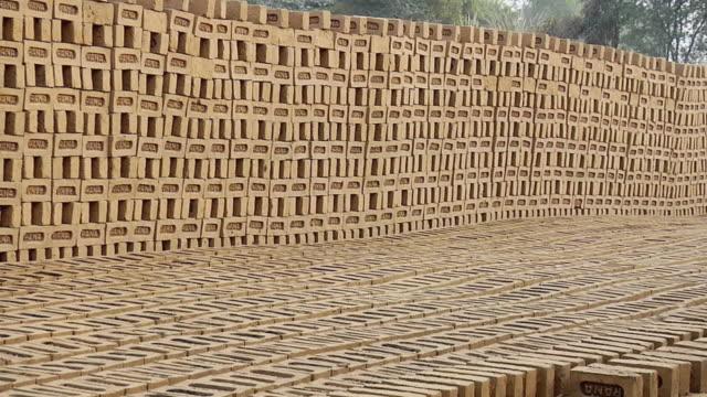 ws zo stack of bricks / sohna, haryana, india - brick stock videos & royalty-free footage