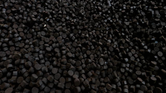 stack of briquettes are seen on march 16, 2017 in melbourne, australia. in november 2016, french owners of the hazelwood power station, engie,... - coal stock videos & royalty-free footage