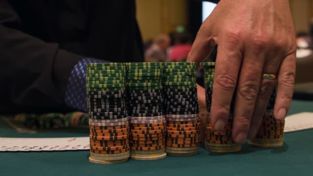 cu stack of casino chips the tournament will feature a poker championship with a $5 million guarantee the largest guaranteed prize pool offered for a... - casino worker stock videos and b-roll footage