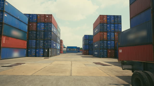stack of container, logistic import export business,dolly shot - box container stock videos & royalty-free footage