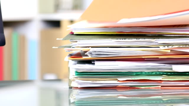 stack of files, documents being removed from office desk. - place of work stock videos & royalty-free footage
