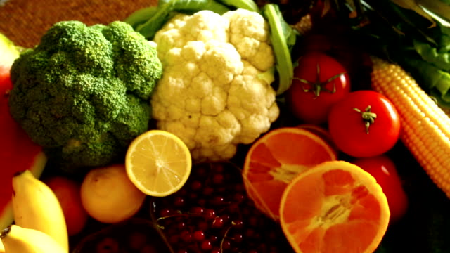 stack of fresh fruits and vegetables. - vegetable stock videos & royalty-free footage
