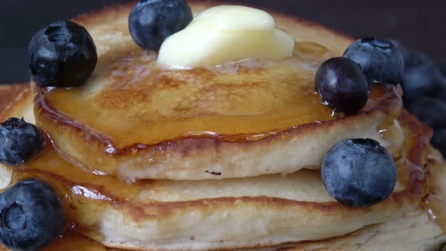 stack of gluten free pancakes with maple syrup and blueberries - gluten free stock videos & royalty-free footage