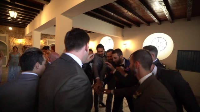 stack of hands showing unity of groomsman or best man and groom before the wedding ceremony - best man stock videos and b-roll footage
