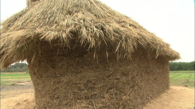 a stack of hay creates a japanese funano. - hay stack stock videos & royalty-free footage