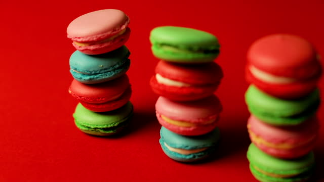 Stack of macaroons on red background