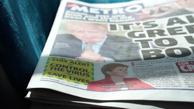 a stack of metro newspapers with the headline its all greek to us boris and the new government guideline of stay alert boris johnson nicola sturgeon... - stack stock videos & royalty-free footage