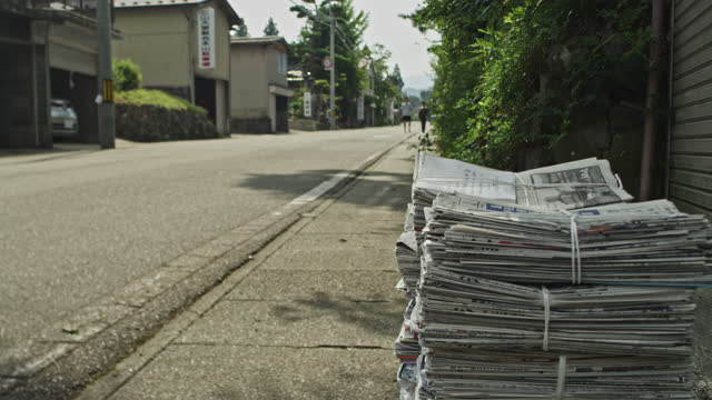 stack of newspapers on street - community stock videos & royalty-free footage