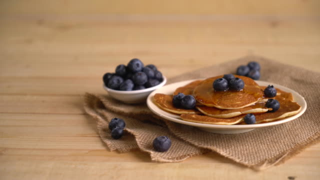 stack of pancakes with fresh blueberry - blueberry stock videos and b-roll footage