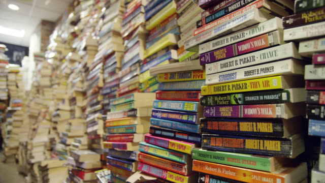 stack of paperbacks - books stock videos and b-roll footage