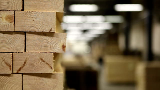 stack of planks and sawmill background - lumberyard stock videos and b-roll footage