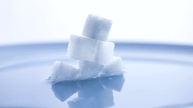 t/l stack of sugarcubes dissolving in water - plaque bacteria stock videos & royalty-free footage