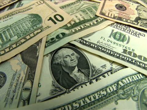 ecu, zi, stack of us dollar bills - banconota da 10 dollari statunitensi video stock e b–roll
