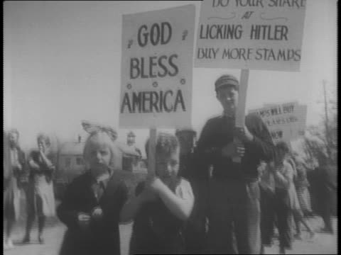 a stack of war bonds sit on a table / two women rapidly flip through sheets of war bonds in factory / men stack pallets high with war bonds wheeled... - god's window stock videos and b-roll footage