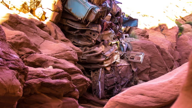 stack of wrecked cars in catstair canyon, utah - time lapse - red rocks stock videos & royalty-free footage