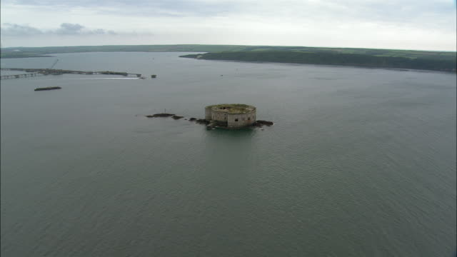 aerial, stack rock fort, milford haven, pembrokeshire, wales - stack rock stock videos and b-roll footage